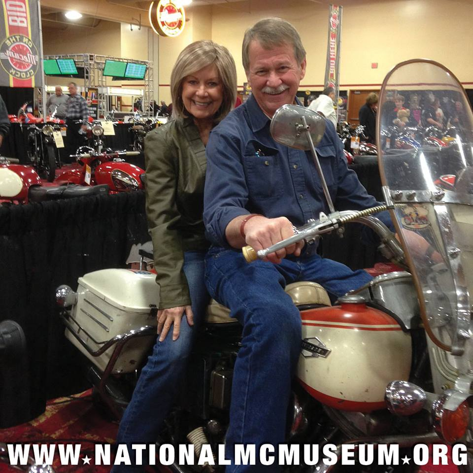 "Among the visitors to the MidAmerica auction are Dee and Jerry Wood. ""I've always wanted a Pan and with how I have busted up my legs road racing, it's gotta be an ElectraGlide!"" This one is an original paint bike and pretty nice."