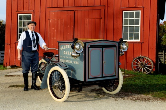 """Mike Schuster stands with """"Walter,"""" the 1913 Harley-Davidson Forecar he has been restoring for about 40 years. The only one known to exist, it will be on display at the National Motorcycle Museum through Spring 2015."""